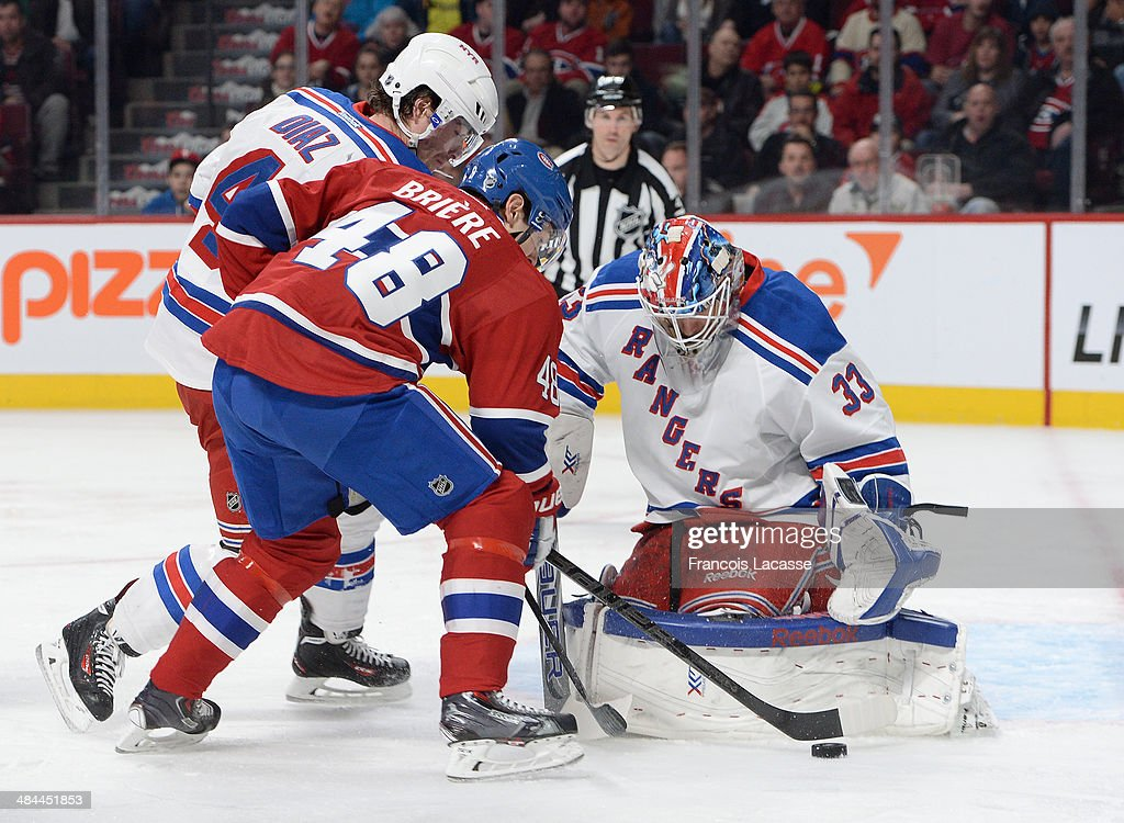 Cam Talbot #33 and Raphael Diaz #4 of the New York Rangers protect the net against Daniel Briere #48 of the Montreal Canadiens during the NHL game on April 12, 2014 at the Bell Centre in Montreal, Quebec, Canada.