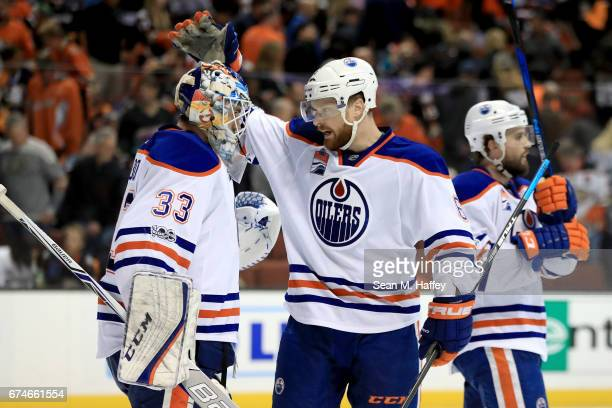 Cam Talbot is congratulated by Adam Larsson of the Edmonton Oilers after defeating the Anaheim Ducks 21 in Game Two of the Western Conference Second...
