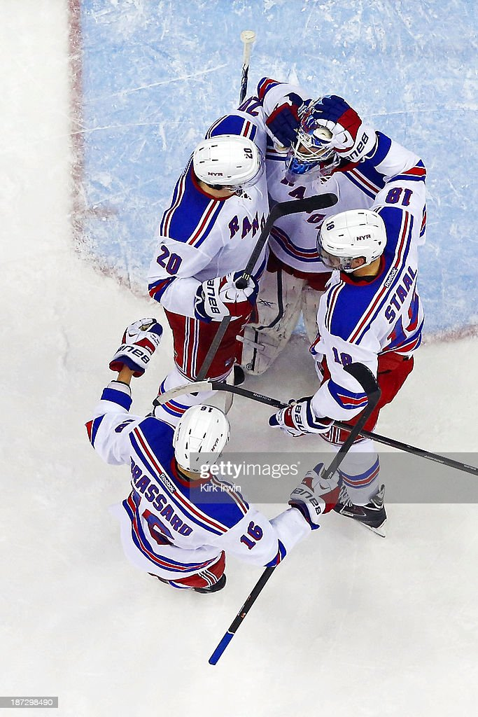 <a gi-track='captionPersonalityLinkClicked' href=/galleries/search?phrase=Cam+Talbot&family=editorial&specificpeople=7185126 ng-click='$event.stopPropagation()'>Cam Talbot</a> #33 is congratulated by <a gi-track='captionPersonalityLinkClicked' href=/galleries/search?phrase=Derick+Brassard&family=editorial&specificpeople=540468 ng-click='$event.stopPropagation()'>Derick Brassard</a> #16, <a gi-track='captionPersonalityLinkClicked' href=/galleries/search?phrase=Chris+Kreider&family=editorial&specificpeople=5894671 ng-click='$event.stopPropagation()'>Chris Kreider</a> #20, and <a gi-track='captionPersonalityLinkClicked' href=/galleries/search?phrase=Marc+Staal&family=editorial&specificpeople=3809026 ng-click='$event.stopPropagation()'>Marc Staal</a> #18, all of the New York Rangers, after defeating the Columbus Blue Jackets 4-2 on November 7, 2013 at Nationwide Arena in Columbus, Ohio.