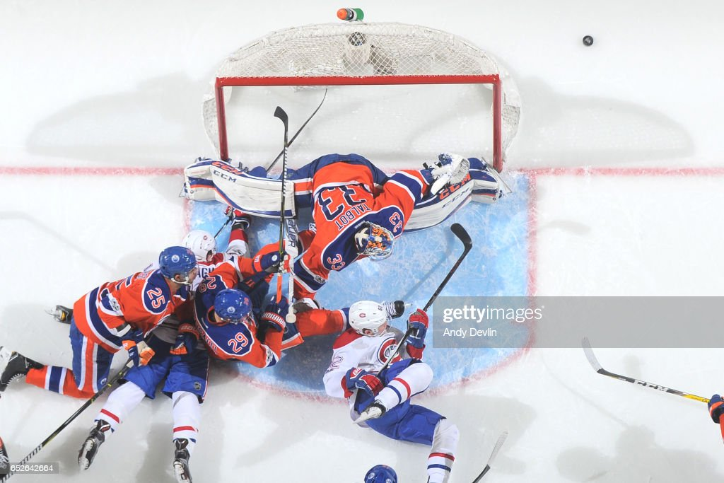 Cam Talbot #33, Leon Draisaitl #29 and Darnell Nurse #25 of the Edmonton Oilers battle to keep the puck out against Artturi Lehkonen #62 and Brendan Gallagher #11 of the Montreal Canadiens on March 12, 2017 at Rogers Place in Edmonton, Alberta, Canada.