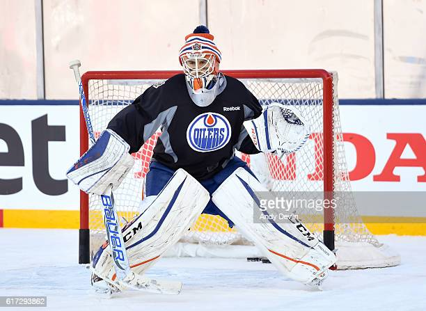 Cam Talbot of the Edmonton Oilers faces shots in practice in advance of the 2016 Tim Hortons NHL Heritage Classic game at Investors Group Field on...