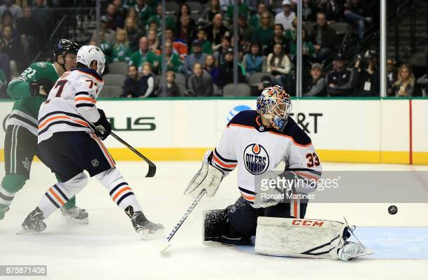 Cam Talbot of the Edmonton Oilers gives up a goal against the Dallas Stars in the first period at American Airlines Center on November 18 2017 in...