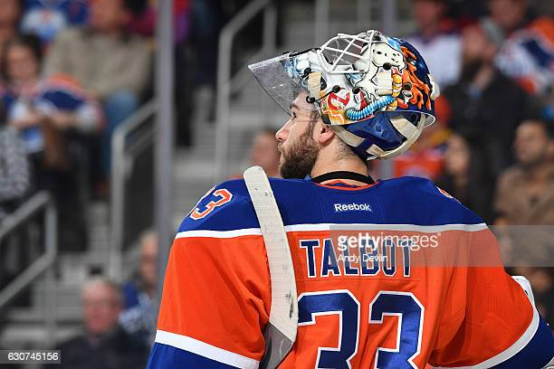 Cam Talbot of the Edmonton Oilers looks at the clock during the game against the Vancouver Canucks on December 31 2016 at Rogers Place in Edmonton...