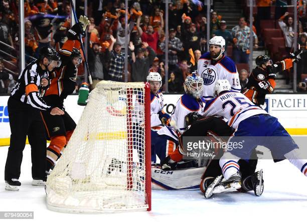 Cam Talbot of the Edmonton Oilers looks back at the net as Rickard Rakell of the Anaheim Ducks scores a goal to tie the game 33 with fifteen seconds...