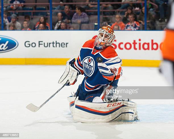 Cam Talbot of the Edmonton Oilers makes a save during a preseason game against the Winnipeg Jets on September 23 2015 at Rexall Place in Edmonton...