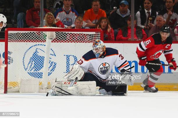 Cam Talbot of the Edmonton Oilers makes a save during the game against the New Jersey Devils at Prudential Center on November 9 2017 in Newark New...