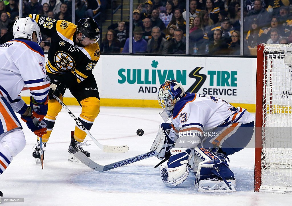Cam Talbot #33 of the Edmonton Oilers makes a save on a shot by Tim Schaller #59 of the Boston Bruins in the third period at TD Garden on January 5, 2017 in Boston, Massachusetts. The Oilers won 4-3.