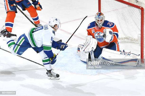 Cam Talbot of the Edmonton Oilers makes a save on a shot from Markus Granlund of the Vancouver Canucks on March 18 2017 at Rogers Place in Edmonton...