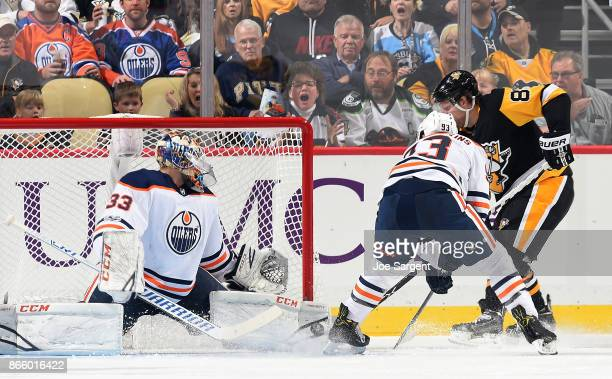 Cam Talbot of the Edmonton Oilers makes a save on Phil Kessel of the Pittsburgh Penguins at PPG Paints Arena on October 24 2017 in Pittsburgh...