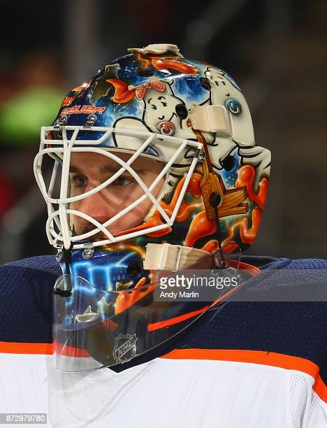 Cam Talbot of the Edmonton Oilers playing in his 200th NHL game looks on during the game against the New Jersey Devils at Prudential Center on...