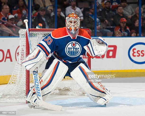Cam Talbot of the Edmonton Oilers prepares to make a save during a preseason game against the Winnipeg Jets on September 23 2015 at Rexall Place in...