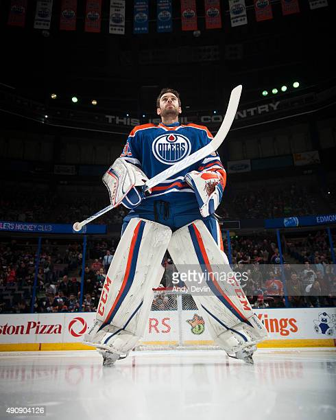 Cam Talbot of the Edmonton Oilers stands for the singing of the national anthem prior to a preseason game against the Vancouver Canucks on October 1...