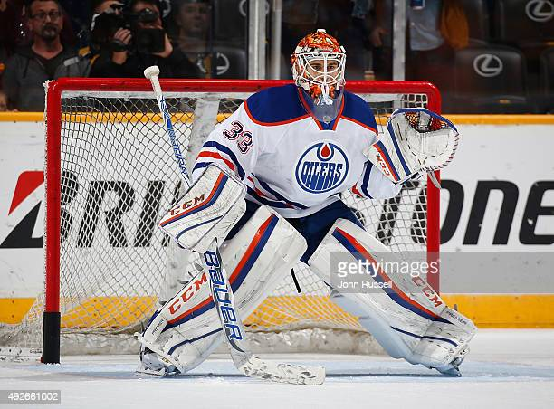 Cam Talbot of the Edmonton Oilers tends net in warmups against the Nashville Predators during an NHL game at Bridgestone Arena on October 10 2015 in...