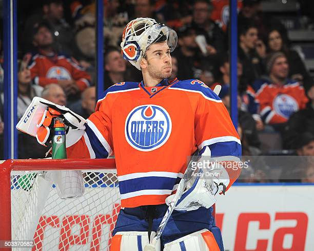 Cam Talbot of the Edmonton Oilers watches the replay during a TV time out in a game against the Winnipeg Jets on December 21 2015 at Rexall Place in...