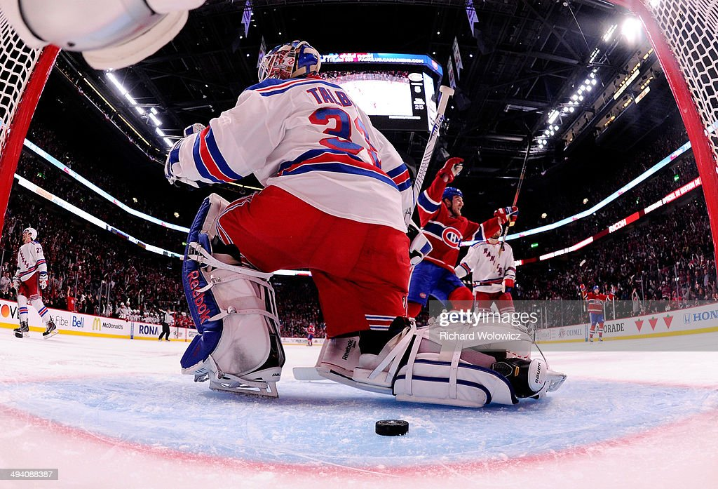 <a gi-track='captionPersonalityLinkClicked' href=/galleries/search?phrase=Cam+Talbot&family=editorial&specificpeople=7185126 ng-click='$event.stopPropagation()'>Cam Talbot</a> #33 of the New York Rangers looks on after giving up a third period goal to <a gi-track='captionPersonalityLinkClicked' href=/galleries/search?phrase=Rene+Bourque&family=editorial&specificpeople=685715 ng-click='$event.stopPropagation()'>Rene Bourque</a> #17 of the Montreal Canadiens (not pictured) at 6:33 during Game Five of the Eastern Conference Final in the 2014 NHL Stanley Cup Playoffs at Bell Centre on May 27, 2014 in Montreal, Canada.