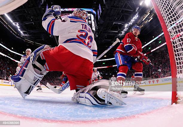 Cam Talbot of the New York Rangers looks on after giving up a third period goal to Rene Bourque of the Montreal Canadiens at 633 during Game Five of...