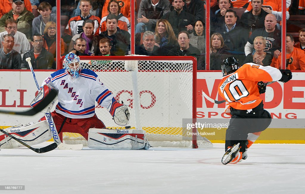 Cam Talbot #33 of the New York Rangers makes a glove save on a shot by Brayden Schenn #10 of the Philadelphia Flyers at the Wells Fargo Center on October 24, 2013 in Philadelphia, Pennsylvania.