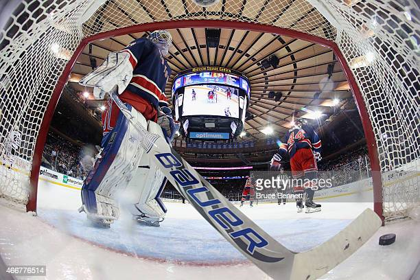 Cam Talbot of the New York Rangers retrieves the game winning goal puck from the net following a goal by Brad Richards of the Chicago Blackhawks...