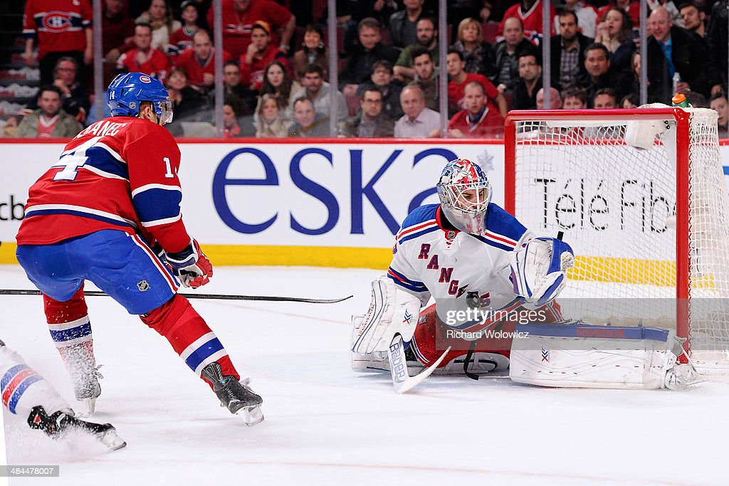 Cam Talbot #33 of the New York Rangers stops the puck on a breakaway attempt by Tomas Plekanec #14 of the Montreal Canadiens during the NHL game at the Bell Centre on April 12, 2014 in Montreal, Quebec, Canada.