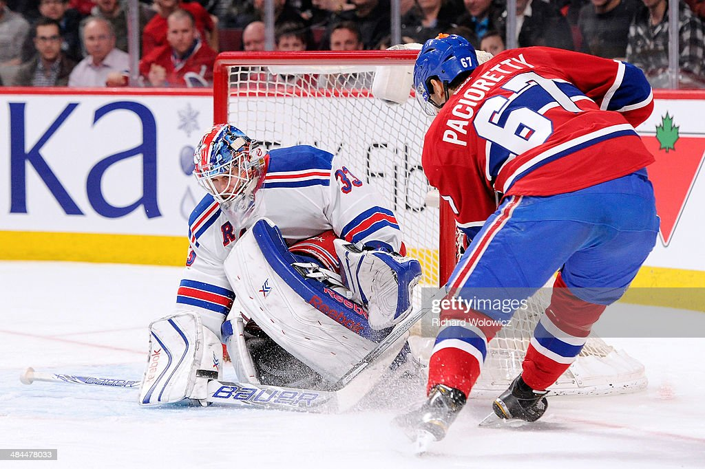 Cam Talbot #33 of the New York Rangers stops the puck on an attempt by Max Pacioretty #67 of the Montreal Canadiens during the NHL game at the Bell Centre on April 12, 2014 in Montreal, Quebec, Canada.