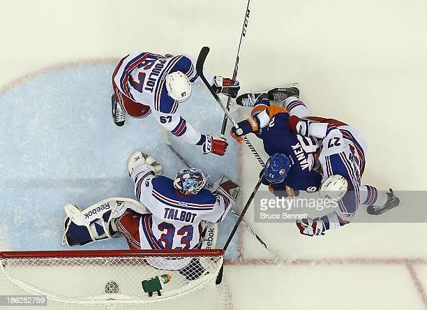 Cam Talbot Ryan McDonagh and Benoit Pouliot of the New York Rangers defend against Thomas Vanek of the New York Islanders at the Nassau Veterans...