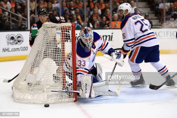 Cam Talbot tends goal as Darnell Nurse of the Edmonton Oilers skates past during the third period of Game Two of the Western Conference Second Round...