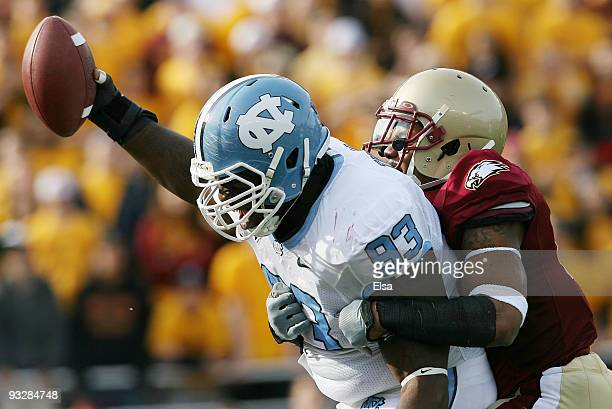Cam Thomas of the North Carolina Tar Heels celebrates as Montel Harris of the Boston College Eagles tries to make the tackle on November 21 2009 at...