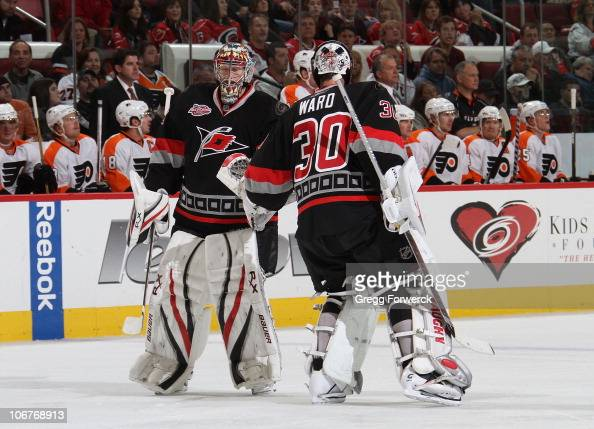 Cam Ward and Justin Peters of the Carolina Hurricanes make a goaltender change during a NHL game against the Philadelphia Flyers on November 11 2010...