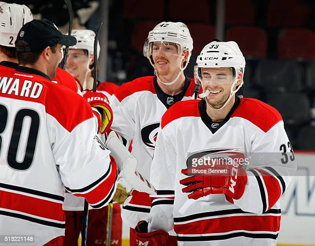 Cam Ward Joakim Nordstrom and Derek Ryan of the Carolina Hurricanes celebrate their 31 victory over the New Jersey Devils at the Prudential Center on...