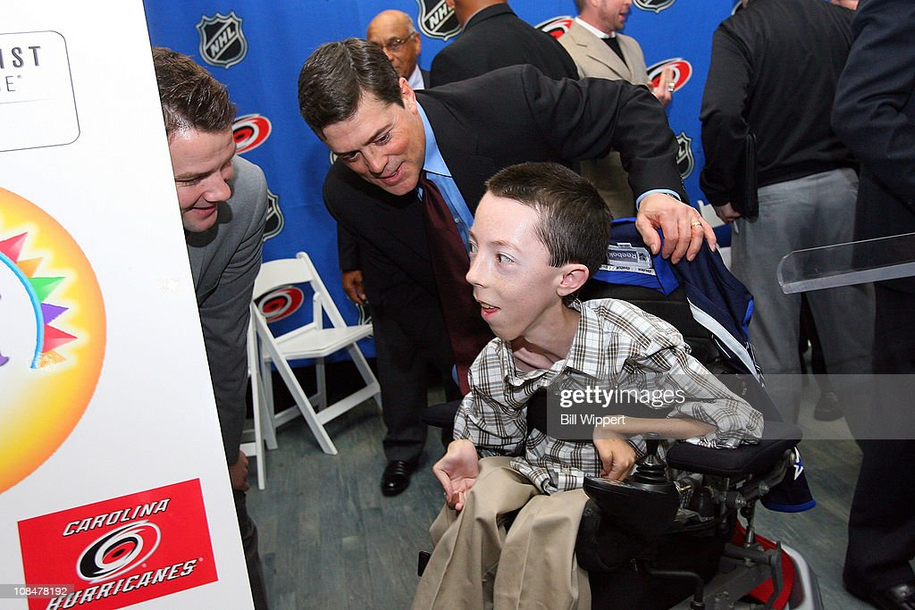 Cam Ward (L) of the Carolina Hurricanes and Pat LaFontaine, President of the Companions in Courage, talk with 16-year old Jonathan Crighton during the Lion's Den 'Champions in Courage' North Carolina Chidren's Hospital Chapel Hill visit as part of 2011 NHL All-Star Weekend on January 28, 2011 in Raleigh, North Carolina.