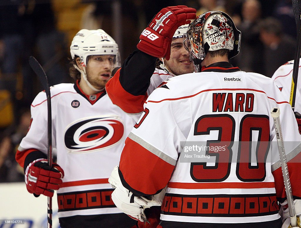 <a gi-track='captionPersonalityLinkClicked' href=/galleries/search?phrase=Cam+Ward&family=editorial&specificpeople=453216 ng-click='$event.stopPropagation()'>Cam Ward</a> #30 of the Carolina Hurricanes celebrates a 3-0 victory over the Boston Bruins with Justin Faulk #28 of the Carolina Hurricanes at TD Garden on February 2, 2012 in Boston, Massachusetts.