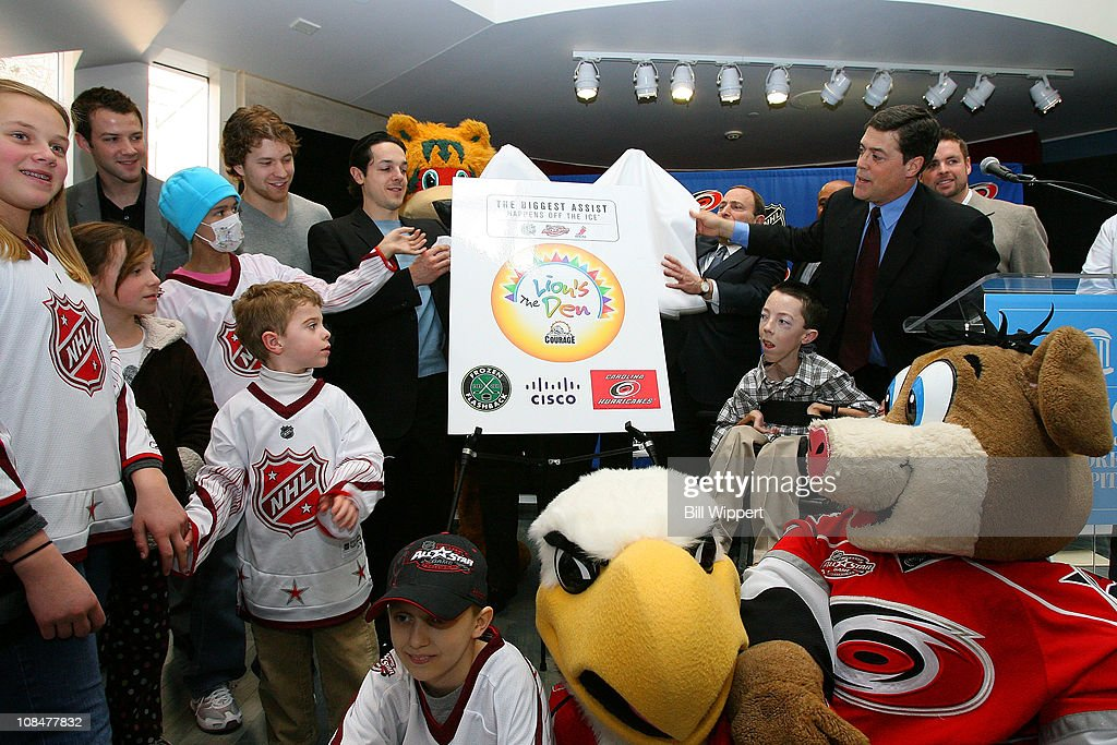 Cam Ward of the Carolina Hurricanes, Claude Giroux of the Philadelphia Flyers, Danny Briere of the Philadelphia Flyers, NHL Commissioner Gary Bettman and Pat LaFontaine, President of Companions in Courage unveil the 'Lion's Den' during the Lion's Den 'Champions in Courage' North Carolina Chidren's Hospital Chapel Hill visit as part of 2011 NHL All-Star Weekend on January 28, 2011 in Raleigh, North Carolina.