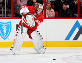 Cam Ward of the Carolina Hurricanes clears the puck during a NHL game against the Detroit Red Wings at PNC Arena on October 10 2015 in Raleigh North...