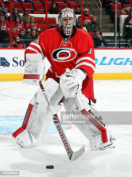 Cam Ward of the Carolina Hurricanes comes out of the crease to play the puck during their NHL game against the Anaheim Ducks at PNC Arena on Febuary...