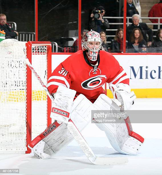 Cam Ward of the Carolina Hurricanes crouches in the crease to protect the net during their NHL game against the Philadelphia Flyers at PNC Arena on...