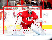 Cam Ward of the Carolina Hurricanes crouches to protect the goal during a NHL game against the Detroit Red Wings at PNC Arena on October 10 2015 in...