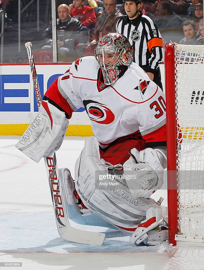 Cam Ward #30 of the Carolina Hurricanes defends his net against the New Jersey Devils during the game at the Prudential Center on February 12, 2013 in Newark, New Jersey.
