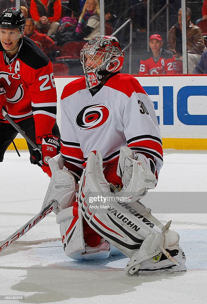 <a gi-track='captionPersonalityLinkClicked' href=/galleries/search?phrase=Cam+Ward&family=editorial&specificpeople=453216 ng-click='$event.stopPropagation()'>Cam Ward</a> #30 of the Carolina Hurricanes defends his net against the New Jersey Devils during the game at the Prudential Center on November 27, 2013 in Newark, New Jersey.