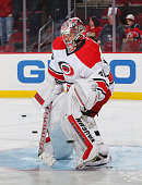 Cam Ward of the Carolina Hurricanes defends the net during pregame warmups prior to the game against the New Jersey Devils at the Prudential Center...