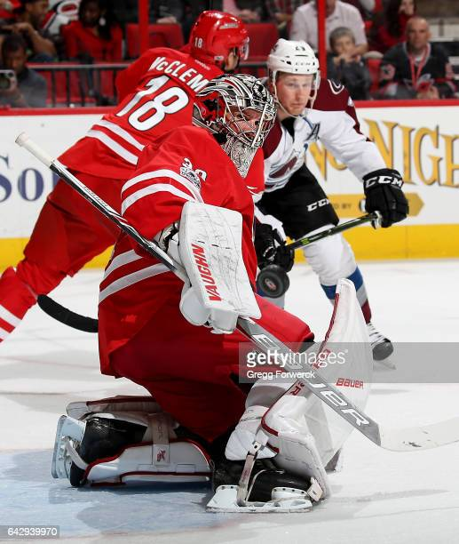 Cam Ward of the Carolina Hurricanes deflects a puck away from the crease during an NHL game against the Colorado Avalanche on February 17 2017 at PNC...