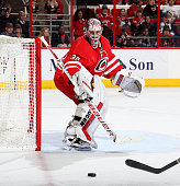 Cam Ward of the Carolina Hurricanes deflects a shot on goal during their NHL game against the the Detroit Red Wings at PNC Arena on April 11 2015 in...