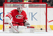 Cam Ward of the Carolina Hurricanes deflects the puck wide of the net during an NHL game agaisnt the Columbus Blue Jackets at PNC Arena on March 10...