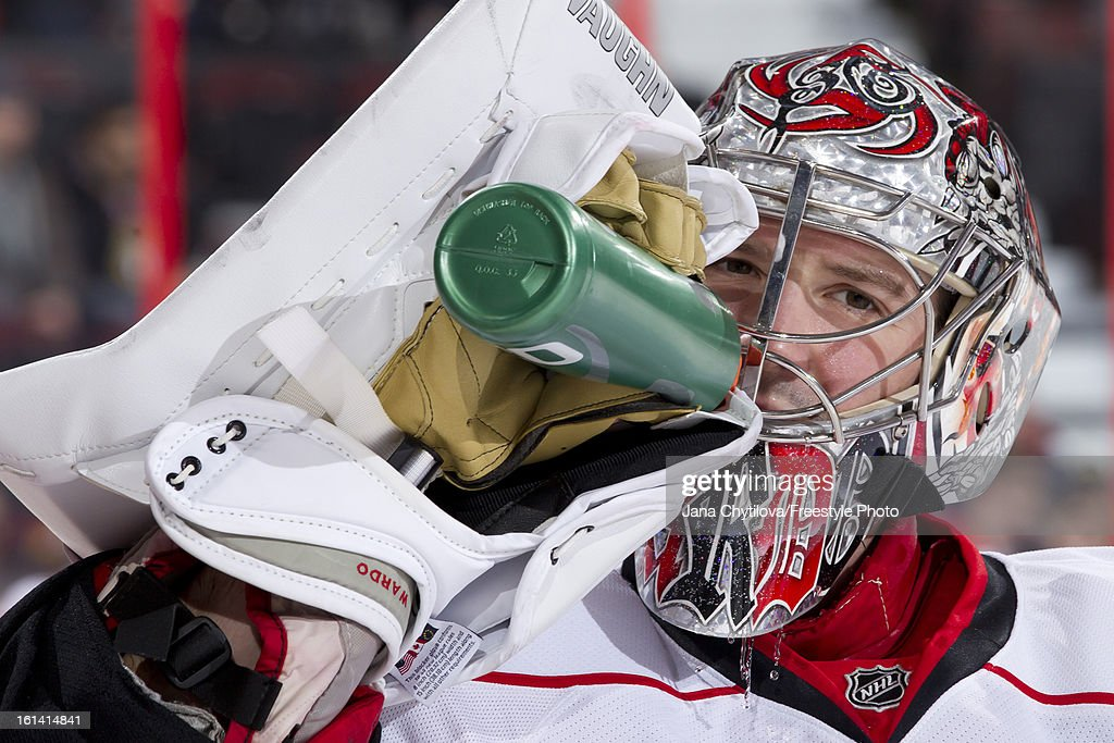 Cam Ward #30 of the Carolina Hurricanes drinks water during warmups prior to an NHL game against the Ottawa Senators at Scotiabank Place on February 7, 2013 in Ottawa, Ontario, Canada.