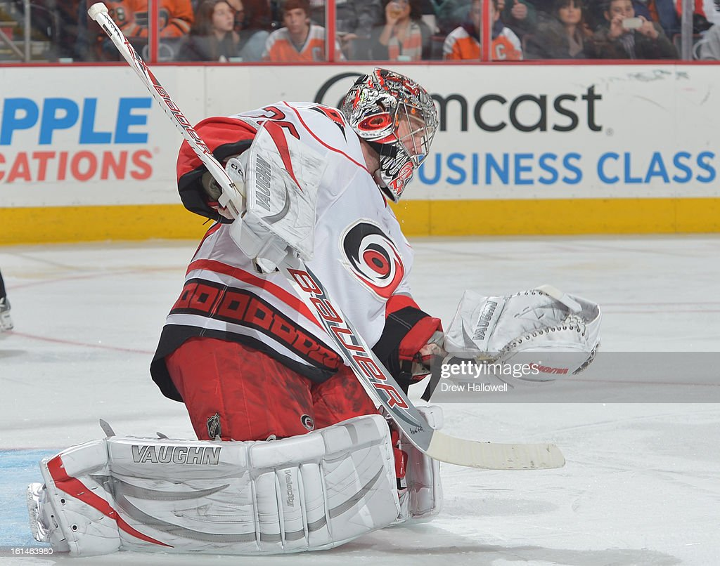 Cam Ward #30 of the Carolina Hurricanes drops to make a save during the game against the Philadelphia Flyers at the Wells Fargo Center on February 9, 2013 in Philadelphia, Pennsylvania.