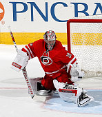 Cam Ward of the Carolina Hurricanes goes down i the crease to make a save during their NHL game against of the Columbus Blue Jackets at PNC Arena on...