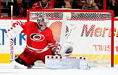 Cam Ward of the Carolina Hurricanes goes down in the crease during a NHL game against the Florida Panthers at PNC Arena on December 18 2015 in...