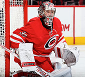 Cam Ward of the Carolina Hurricanes goes down in the crease to protect the net during their NHL game against the New Jersey Devils at PNC Arena on...