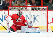 Cam Ward of the Carolina Hurricanes goes down in the crease to protect the net during their NHL game against the Anaheim Ducks at PNC Arena on...