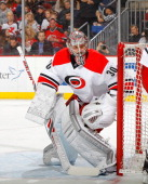 Cam Ward of the Carolina Hurricanes in action against the New Jersey Devils at the Prudential Center on March 8 2014 in Newark New Jersey The Devils...