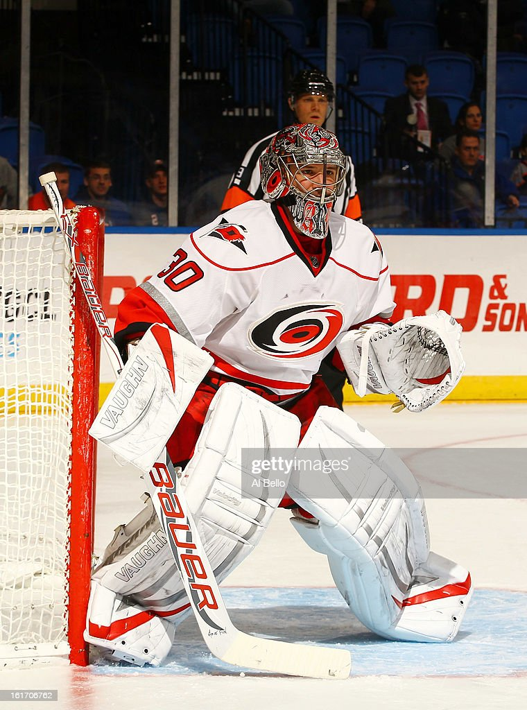 Cam Ward #30 of the Carolina Hurricanes in action against the New York Islanders during their game at Nassau Veterans Memorial Coliseum on February 11, 2013 in Uniondale, New York.